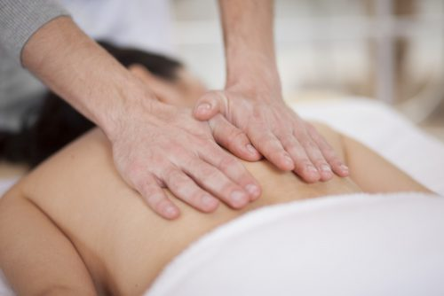 massage therapist working with client