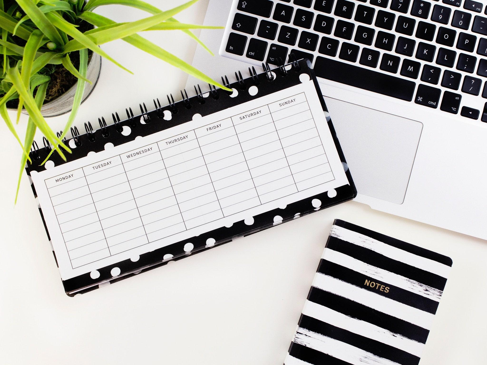 planner, laptop, and calendar